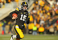 November 23 2013: Iowa Hawkeyes quarterback Jake Rudock (15) scrambles with the ball during the first quarter of the NCAA football game between the Michigan Wolverines and the Iowa Hawkeyes at Kinnick Stadium in Iowa City, Iowa on November 23, 2013. Iowa defeated Michigan 24-21.