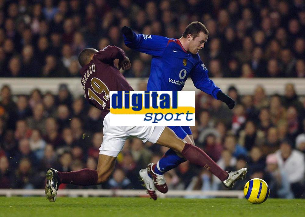 Photo: Daniel Hambury.<br />Arsenal v Manchester United. The Barclays Premiership.<br />03/01/2006.<br />Arsenal's Gilberto slides in on United's Wayne Rooney.