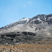 A view looking back at Lava Tower Camp (15,200 feet) at left, with Kibo Summit and part of the Western Breach to the right. Mt Kilimanjaro.