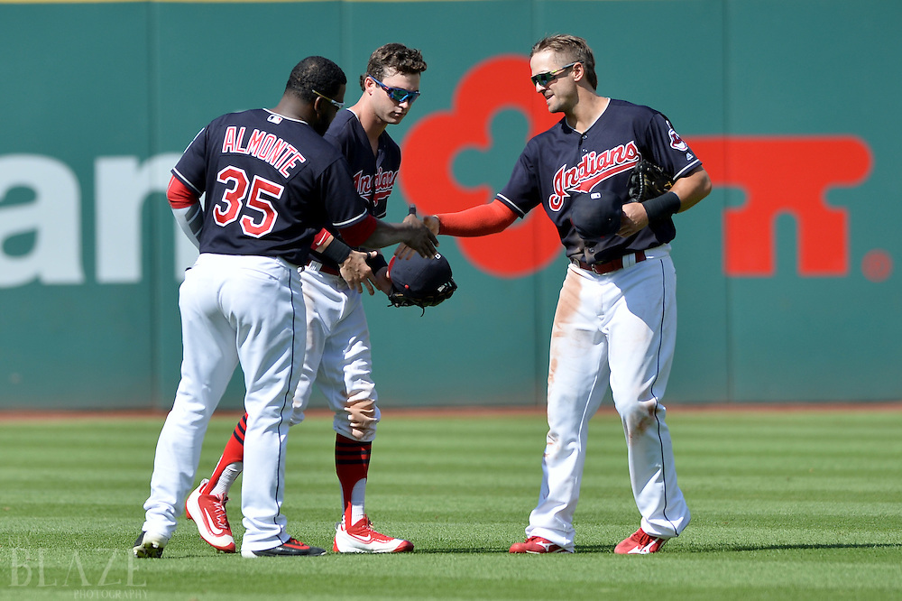 Jul 31, 2016; Cleveland, OH, USA; Cleveland Indians left fielder Abraham Almonte (35), center fielder Tyler Naquin (30) and right fielder Lonnie Chisenhall (8) celebrate the Indians 8-0 win over the Oakland Athletics at Progressive Field. Mandatory Credit: Ken Blaze-USA TODAY Sports