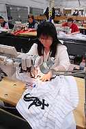 4/3/09 10:49:26 AM -- Easton, PA, U.S.A. -- Barbara Graver, a seamstress at Majestic Athletic sews lettering on the back of a Chicago White Sox jersey April 3, 2009 in Easton, Pennsylvania. White Sox jerseys and gear have experienced a boost in sales with Obama, a White Sox fan, in the White House. -- .Photo by William Thomas Cain,  cainimages.com.