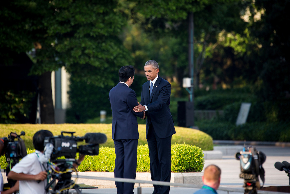 HIROSHIMA, JAPAN - MAY 27 : U.S. President Barack Obama (right) shake hands with Prime Minister Shinzo Abe (left) in front of cenotaph in the Hiroshima Peace Memorial Park in Hiroshima, Japan on May 27, 2016. US President Barack Obama is the first American president to visit Hiroshima after United States of America dropped Atomic bomb in Hiroshima on August 6, 1945.<br /> <br /> Photo: Richard Atrero de Guzman<br /> <br />  <br /> <br /> <br /> <br /> <br /> <br /> Photo: Richard Atrero de Guzman