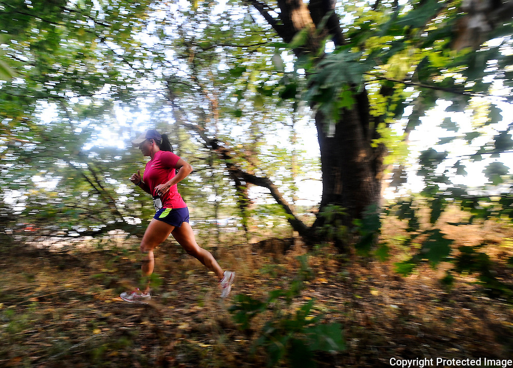 "Kris Wilson/News Tribune.A runner makes her way through one last wooded stretch as she approaches the finish line while competing in the Jefferson City Rotaract Club's ""Kicks In The Sticks"" Trail Scramble at Binder Park on Saturday."
