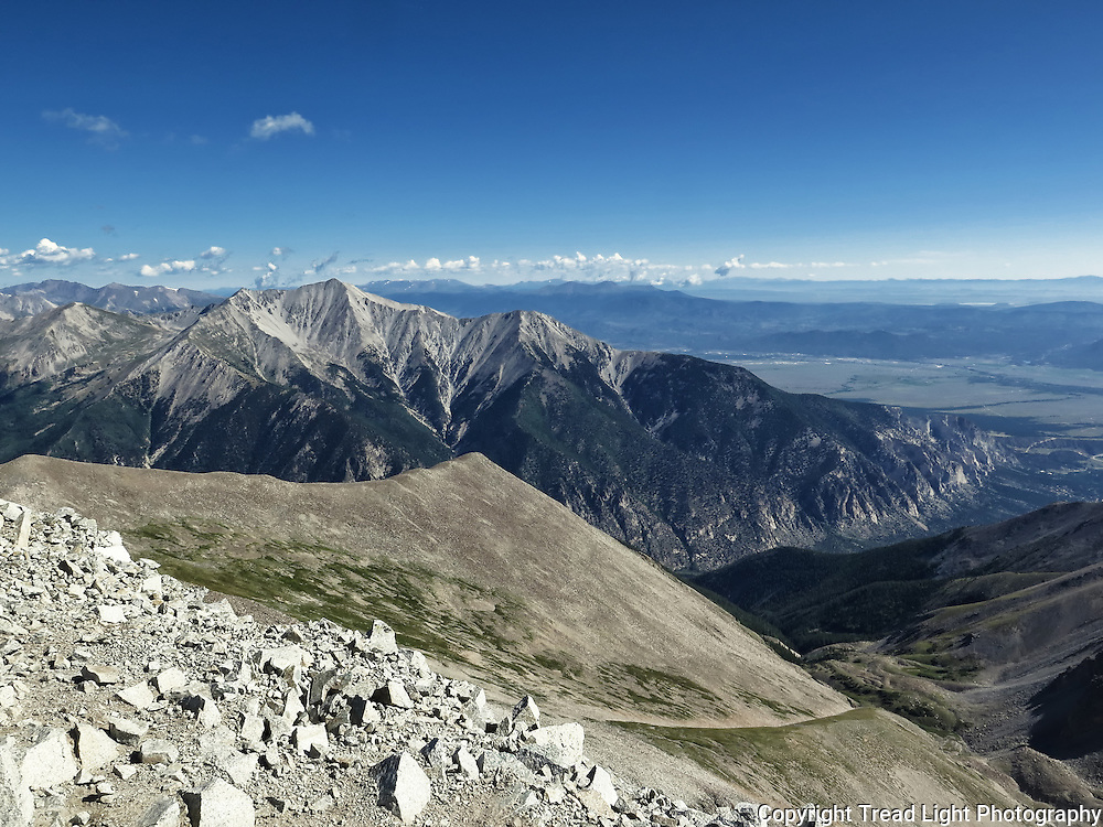 Stunning views from Mt. Antero's summit include it's prominent neighbor, who's distinctive limestone base is evident by the sunlight illuminating chalk cliffs right of center at the base of Princeton.