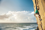 Climbers enjoying a climbing trip to Casal Pianos crack climbing area close to the Atlantic Sea in Portugal