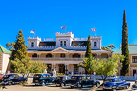 "Lord Milner Hotel, with vintage cars in front, Matjiesfontein. Rovos Rail train ""Pride of Africa"" on it's journey between Pretoria and Cape Town, South Africa."