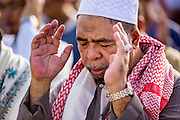 28 JULY 2014 - KHLONG HAE, SONGKHLA, THAILAND: A man prays during Eid services at Songkhla Central Mosque in Songkhla province of Thailand. Eid al-Fitr is also called Feast of Breaking the Fast, the Sugar Feast, Bayram (Bajram), the Sweet Festival and the Lesser Eid, is an important Muslim holiday that marks the end of Ramadan, the Islamic holy month of fasting.   PHOTO BY JACK KURTZ