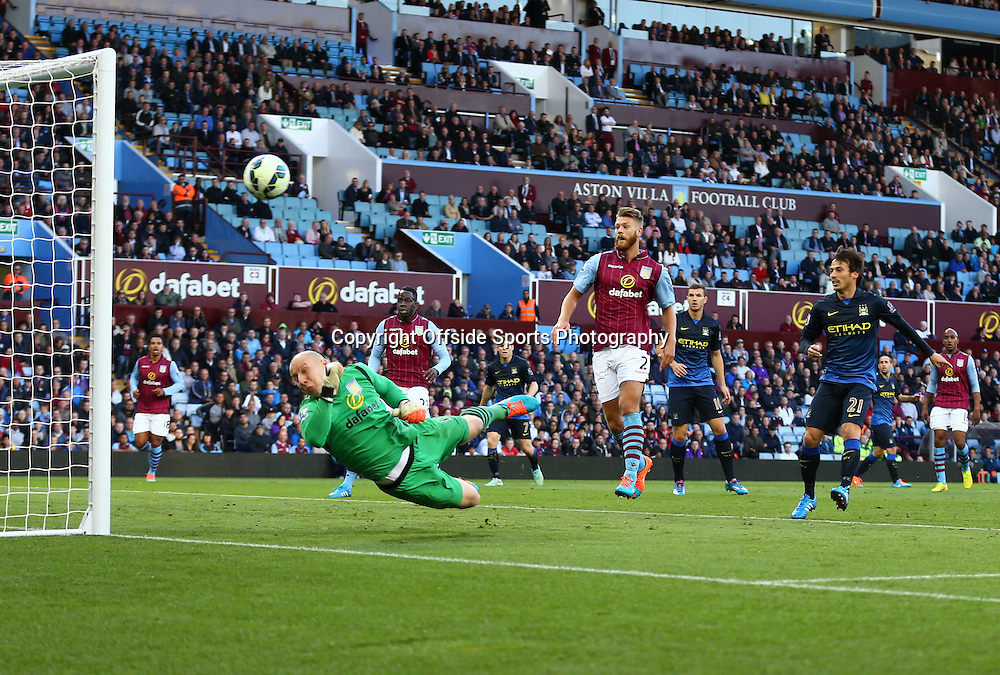 4 October 2014 - Barclays Premier League - Aston Villa v Manchester City - Brad Guzan of Aston Villa dives in vain as Aleksandar Kolarov of Manchester City hits the post - Photo: Marc Atkins / Offside.