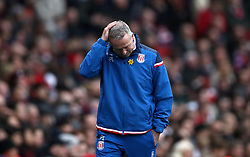 Stoke City manager Paul Lambert gestures on the touchline during the Premier League match at The Emirates Stadium, London.