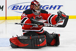 Dec 10, 2008; Newark, NJ, USA; New Jersey Devils goalie Scott Clemmensen (35) makes a glove save during the third period at the Prudential Center. The Devils defeated the Penguins 4-1.