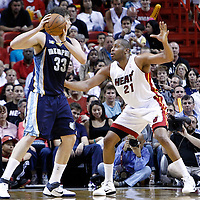 12 March 2011: Miami Heat center Jamaal Magloire (21) defends on Memphis Grizzlies center Marc Gasol (33) during the Miami Heat 118-85 victory over the Memphis Grizzlies at the AmericanAirlines Arena, Miami, Florida, USA. **