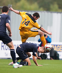 Falkirk's Will Vaulks under Dumbarton's Garry Fleming.<br /> Falkirk 1 v 2 Dumbarton, Scottish Championship game played today at the Falkirk Stadium.<br /> &copy;Michael Schofield.