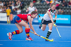 Surbiton's Rebecca Middleton goes past Amy Costello of University of Birmingham. University of Birmingham v Surbiton - Semi-Final - Investec Women's Hockey League Finals, Lee Valley Hockey & Tennis Centre, London, UK on 22 April 2017. Photo: Simon Parker
