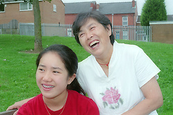 Young girl and grandmother laughing,