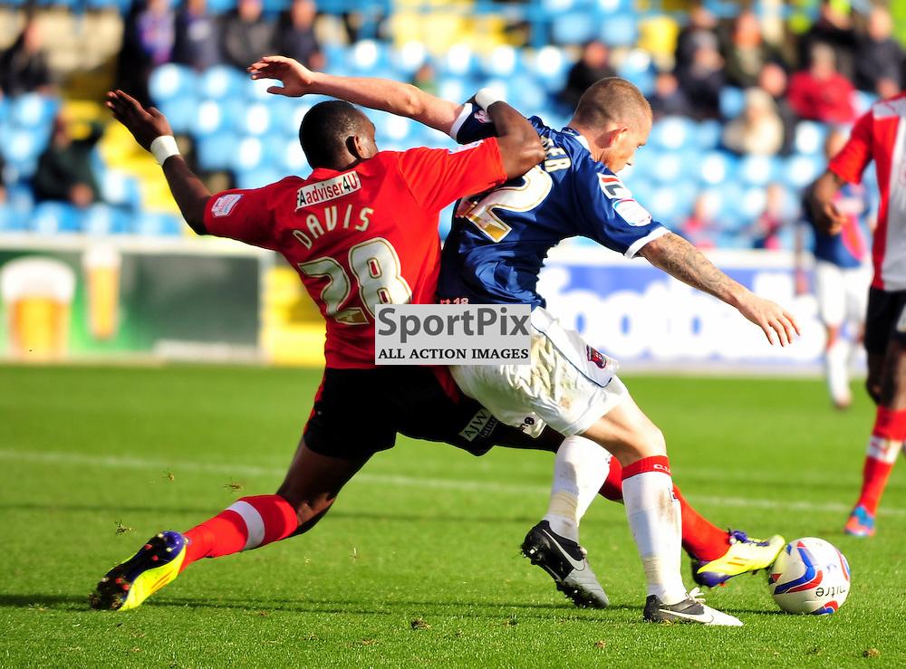 Claude Davis (Crawley Town, red) and Joe Garner. .Carlisle v Crawley, Npower League One, 29th September 2012..(c)  Alex Todd | StockPix.eu