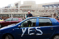 James McLeod Yes supporter paints his car outisde of the Scottish Parliament. <br /> Members of different political ideal gather in the scottish parliament due what Today 18th September is the Scottish Referendum. Pako Mera/Universal News And Sport (Europe) 18/09/2014