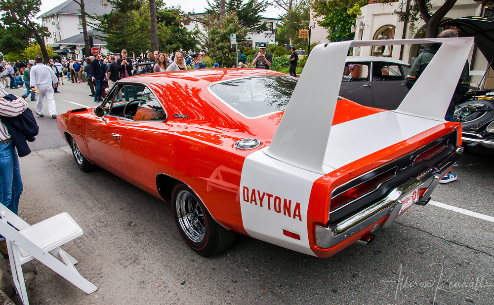 An orange Charger Daytona on display at the 2017 Carmel-by-the-Sea Concours on the Avenue