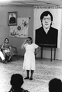 A witness to the assasination of Fr. Octavia Ortiz Luna explains her experience to visitors. El Despertar retreat centre, San Salvador, 1999.