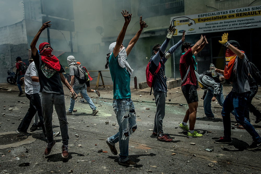 CARACAS, VENEZUELA - APRIL 19, 2017:  Thousands of protesters took to the streets today in Venezuela to protest their discontent with the government.  They were met by riot police that fired tear gas and rubber bullets at them.  Some protesters responded by throwing rocks and petrol bombs.  Venezuela is in crisis, and residents face daily struggles over food and medicine shortages, and one of the highest crime rates in the world.  PHOTO: Meridith Kohut