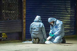 © Licensed to London News Pictures. 05/02/2020. London, UK. Forensic investigators gather evidence after the Metropolitan Police Service won Tuesday 4th Feb as called to Kingsley Rd in Hounslow at 19:23GMT to reports of a fight. A 19-year-old man then self-presented at a hospital with stab injuries. One person has been arrested. Photo credit: Peter Manning/LNP