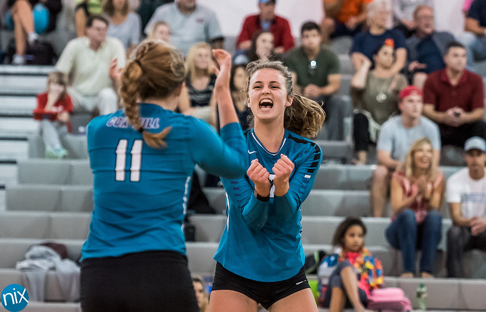 Cox Mill's Taylor Rowland (12) and Courtney Weber (11) celebrate a point against Carson during the South Piedmont Conference volleyball championship game. at Cox Mill High School Wednesday night. Cox Mill won the championship 22-25, 25-17, 25-19, 25-12.