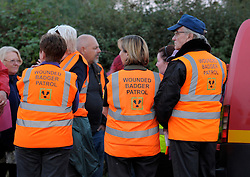 © Licensed to London News Pictures. 06/09/2013. Eldersfield, Gloucestershire, UK. Campaigners on the Wounded Badger Patrol when Brian May visited the badger culling zone in West Gloucestershire to lend support to the campaign against the cull.  Brian is an outspoken opponent of the badger cull and has a charity called Save Me.  The Government has licensed a pilot badger cull as part of efforts to reduce boving turberculosis in cows on farms.  06 September 2013.<br /> Photo credit : Simon Chapman/LNP