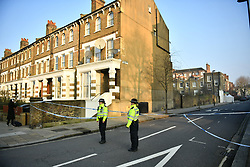 © Licensed to London News Pictures. 21/02/2018. London, UK. The scene on Bartholomew Road, Camden, where one of two stabbings took place yesterday evening, killing two young men. Police were called to a second disturbance in the area, in which  a second man was stabbed to death, and are currently investigating if the two incidents are connected. Photo credit: Ben Cawthra/LNP