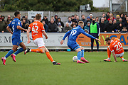 AFC Wimbledon striker Joe Pigott (39) about to dribble past Blackpool defender Oliver Turton (20) during the EFL Sky Bet League 1 match between AFC Wimbledon and Blackpool at the Cherry Red Records Stadium, Kingston, England on 22 February 2020.