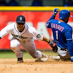SEATTLE, WASHINGTON - APRIL 14: Seattle Mariners infielder Dustin Ackley (13) is late with a tag on Elvis Andrus (1) of the Texas Rangers. (Photo by Christopher Mast/Grand Salami Magazine)