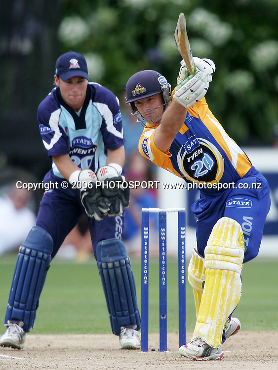 Otago Volts batsman Gareth Hopkins plays a cover drive as Auckland Aces wicketkeeper Reece Young watches on during the State Twenty20 cricket final between the State Auckland Aces and the State Otago Volts held at the Eden Park Outer Oval in Auckland, New Zealand on Sunday, 4 February, 2007. The Auckland Aces won the match by 60 runs. Photo: Tim Hales/PHOTOSPORT