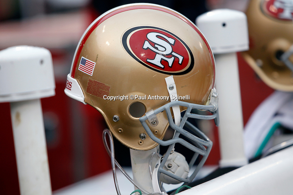 A San Francisco 49ers helmet sits on the bench during the NFL week 17 football game against the Arizona Cardinals on Sunday, January 2, 2011 in San Francisco, California. The 49ers won the game 38-7. (©Paul Anthony Spinelli)