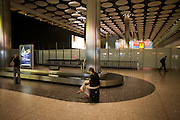 Last ladies awaiting their luggage from domestic baggage reclaim carousel at Heathrow's Terminal 5.