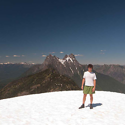 Roddy at Desolation Peak Snowfield in front of Hozomeen, North Cascades National Park, Washington, US