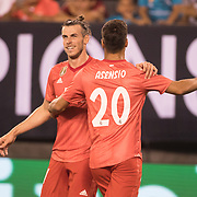 MEADOWLANDS, NEW JERSEY- August 7:  Gareth Bale #11 of Real Madrid is congratulated by Marco Asensio #20 of Real Madrid after scoring his sides second goal during the Real Madrid vs AS Roma International Champions Cup match at MetLife Stadium on August 7, 2018 in Meadowlands, New Jersey. (Photo by Tim Clayton/Corbis via Getty Images)