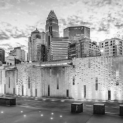 Charlotte NC skyline black and white panoramic picture with Romare Bearden Park at dusk. Panoramic picture ratio is 1:3. Charlotte, North Carolina is a major city in the Eastern United States of America.