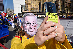 © Licensed to London News Pictures. 01/04/2019. LONDON, UK.  A Pro-Remain supporter wears a Michael Gove face-mask during a protest outside the Houses of Parliament as MPs debate eight motions related to Brexit with voting to begin later this evening.  Photo credit: Stephen Chung/LNP