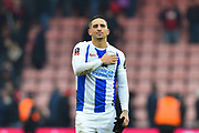 Anthony Knockaert (11) of Brighton and Hove Albion touches the badge on his shirt as he celebrates the 3-1 win over Bournemouth at full time during the The FA Cup 3rd round match between Bournemouth and Brighton and Hove Albion at the Vitality Stadium, Bournemouth, England on 5 January 2019.