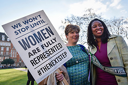 © Licensed to London News Pictures. 06/02/2018. LONDON, UK.  (L to R) Emily Thornberry and Dawn Butler join female members of the Shadow Cabinet and Labour politicians outside the Houses of Parliament, wearing Labour styled suffragette rosettes, to help launch Labour's campaign to celebrate 100 years of women's suffrage.    Photo credit: Stephen Chung/LNP