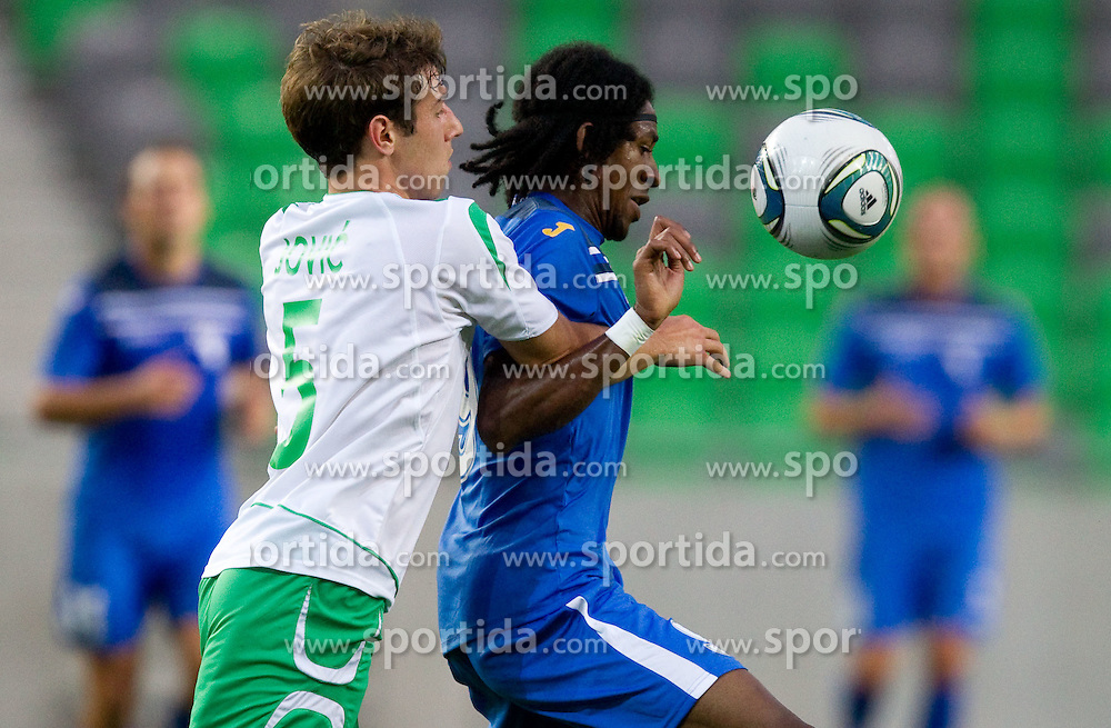 Boban Jovic of NK Olimpija Ljubljana vs William Franklin Vicente of Gorica during football match between NK Olimpija Ljubljana and HIT Gorica of 3rd Round of PrvaLiga 2011/2012, on July 31, 2011, in SRC Stozice, Ljubljana, Slovenia. (Photo by Vid Ponikvar / Sportida)
