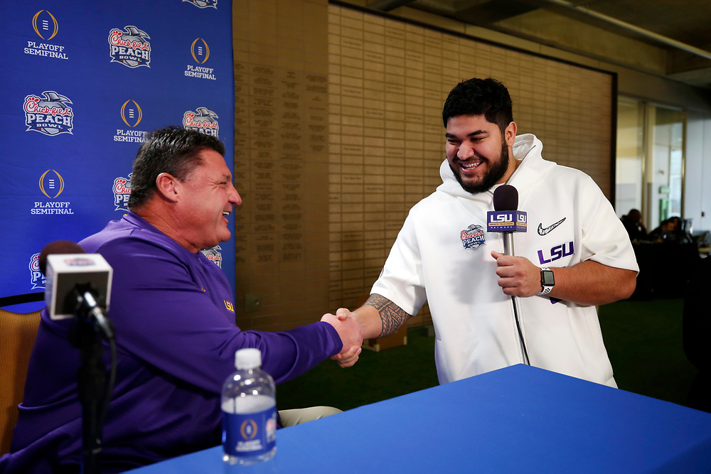 Head coach Ed Orgeron of the LSU Tigers is interviewed by Breiden Fehoko #91 of the LSU Tigers at Media Day on Thursday, Dec. 26, in Atlanta. LSU will face Oklahoma in the 2019 College Football Playoff Semifinal at the Chick-fil-A Peach Bowl. (Jason Parkhurst via Abell Images for the Chick-fil-A Peach Bowl)