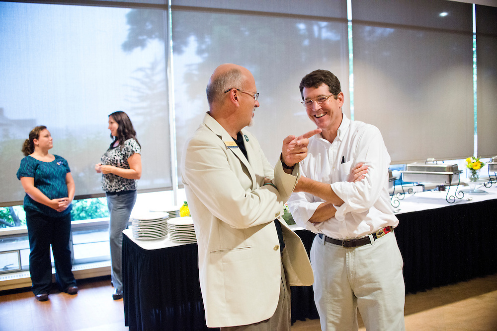 (photo by Matt Roth).Friday, July 20, 2012..Dr. Roger Casey, president of McDaniel College talks with parent Timothy Blair, from Birmingham, AL during the President's Banquet at The Forum in Decker College Center during McDaniel College's Parent Preview Friday, July 20, 2012.