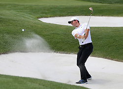 August 9, 2018 - St. Louis, Missouri, United States - Rory McIlroy hits out of a greenside bunker on the 8th hole during the first round of the 100th PGA Championship at Bellerive Country Club. (Credit Image: © Debby Wong via ZUMA Wire)
