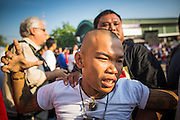"""23 MARCH 2013 - NAKHON CHAI SI, NAKHON PATHOM, THAILAND:  A man goes into a trance state at the Wat Bang Phra tattoo festival. Wat Bang Phra is the best known """"Sak Yant"""" tattoo temple in Thailand. It's located in Nakhon Pathom province, about 40 miles from Bangkok. The tattoos are given with hollow stainless steel needles and are thought to possess magical powers of protection. The tattoos, which are given by Buddhist monks, are popular with soldiers, policeman and gangsters, people who generally live in harm's way. The tattoo must be activated to remain powerful and the annual Wai Khru Ceremony (tattoo festival) at the temple draws thousands of devotees who come to the temple to activate or renew the tattoos. People go into trance like states and then assume the personality of their tattoo, so people with tiger tattoos assume the personality of a tiger, people with monkey tattoos take on the personality of a monkey and so on. In recent years the tattoo festival has become popular with tourists who make the trip to Nakorn Pathom province to see a side of """"exotic"""" Thailand. The 2013 tattoo festival was on March 23.  PHOTO BY JACK KURTZ"""