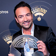 NLD/Hilversum/20180125 - Gouden RadioRing Gala 2017, dj Gerard Ekdom met zijn prijs