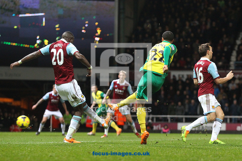 Picture by Paul Chesterton/Focus Images Ltd +44 7904 640267<br /> 11/02/2014<br /> Martin Olssen of Norwich has a shot on goal during the Barclays Premier League match at the Boleyn Ground, London