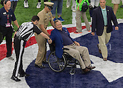HOUSTON, TX - OCTOBER 30: Former President George H. W. Bush is greeted by a referee before performing the coin tossduring the NFL football game between the Detroit Lions and Houston Texans on October 30, 2016 at NRG Stadium in Houston, TX. (Photo by Leslie Plaza Johnson/Icon Sportswire)