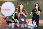 Ashley Speece , left and Iman Abukamail learn about physics while shooting a marshmallow gun during the Tech Savvy workshop CSI Athens at Ohio University May 17, 2014.  The full day event exposes girls from sixth through ninth grade to the field of science, technology, engineering and math.    Photo by Ohio University / Jonathan Adams