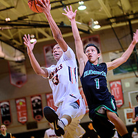 022515  Adron Gardner/Independent<br /> <br /> Gallup Bengal Cody Tabaha (13) attempts the final shot of the third quarter as Farmington Scorpion Diego Corley (1) gives chase during the district 1-5A championship at Gallup High School Monday.