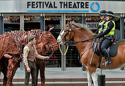 Joey, the life-sized puppet horse from the hit production of War Horse, arrived outside the Festival Theatre in Edinburgh with actor Thomas Dennis, who plays Albert, where he met up with police horses Lewis and Kilmarnock, ridden by PC Kaeren Muir (back) and PC Claire Hunter (front)<br /> <br /> © Dave Johnston/ EEm