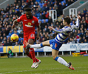 Reading midfielder, Oliver Norwood gets a late foot in and concedes a potentially dangerous freekick during the Sky Bet Championship match between Reading and Blackburn Rovers at the Madejski Stadium, Reading, England on 20 December 2015. Photo by Andy Walter.